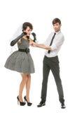 Ragazzo e ragazza che assomigliano alle bambole Immagine Stock