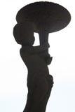 Ragazzo e statua della torcia Immagini Stock Libere da Diritti