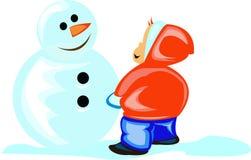 Ragazzo e un pupazzo di neve Immagini Stock