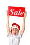 Ragazzo emozionante con il segno di vendita Fotografie Stock Libere da Diritti