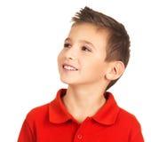 Ragazzo felice abbastanza giovane che osserva via Fotografie Stock Libere da Diritti