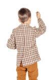 Ragazzo felice adorabile del ritratto giovane che esamina macchina fotografica isolata sopra Immagine Stock Libera da Diritti