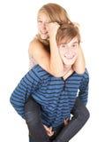 Ragazzo felice che dà a ragazza un a due vie Fotografie Stock Libere da Diritti