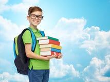 Ragazzo felice dello studente con la borsa ed i libri di scuola Immagine Stock