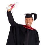 Ragazzo felice dopo la sua graduazione immagini stock libere da diritti