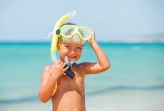 Ragazzo felice sulla spiaggia Fotografie Stock Libere da Diritti