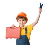 Ragazzo felice vestito come muratore con il corredo di strumenti Fotografia Stock