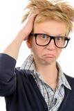 Ragazzo frustrato del nerd in vetri del geek fotografia stock