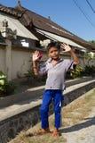 Ragazzo indonesiano sulla via di Toyapakeh Fotografia Stock