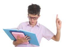 Ragazzo nerd con i libri Immagini Stock