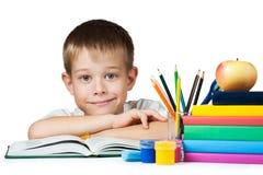 Ragazzo piacevole con i libri e le matite Fotografia Stock