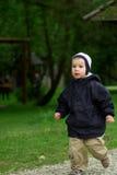 ragazzo piccolo che funziona fotografie stock