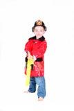 Ragazzo prescolare di età in costume del vigile del fuoco Fotografia Stock Libera da Diritti