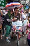 ragazzo signora alla dimostrazione antigovernativa Tailandia Fotografia Stock