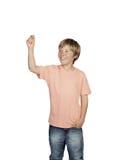 Ragazzo sorridente che solleva la sua tenuta del braccio qualcosa Immagine Stock