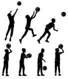 Ragazzo stabilito delle siluette che gioca pallacanestro immagine stock libera da diritti