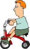 Ragazzo su un triciclo Immagine Stock