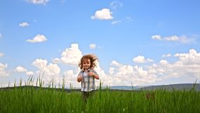 Cute Boy Jumping In Green Meadow Stock Footage