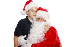 Ragazzo sveglio con Santa Fotografie Stock Libere da Diritti