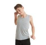 Ragazzo sveglio dell'adolescente sopra fondo bianco Immagini Stock Libere da Diritti