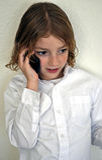 Ragazzo sveglio della gioventù che comunica sul telefono Fotografie Stock Libere da Diritti