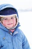 Ragazzo sveglio in snowsuit Fotografia Stock