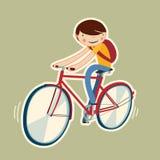 Ragazzo sveglio su una bici Immagine Stock