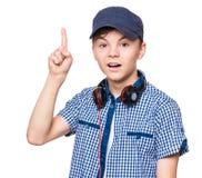 Ragazzo teenager con il cappuccio e le cuffie Fotografia Stock Libera da Diritti