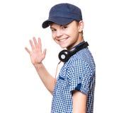 Ragazzo teenager con il cappuccio e le cuffie Fotografia Stock