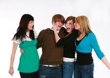 Ragazzo teenager con tre ragazze Fotografie Stock Libere da Diritti