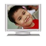 Ragazzo in televisione dell'affissione a cristalli liquidi Immagine Stock Libera da Diritti