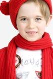 Ragazzo in una protezione rossa Fotografia Stock