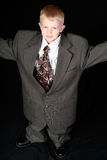 Ragazzo in vestito di affari del papà Fotografia Stock
