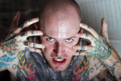 Rage. Angry man covered with tattoos Stock Images