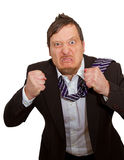 Rage. A very angry business man Stock Photo