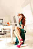 Rage. Furious woman throw clock, sit in white modern room Stock Images