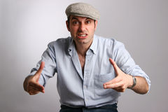 Rage. A young man on a grey background Royalty Free Stock Photography