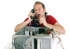 Rage against technology. Very upset man lost in computer cables yelling at hotline support Stock Photos