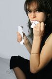 Rage and anger. Angry young woman tears paper into pieces Stock Photography