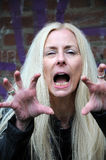 Rage attack. Blond mid aged woman having rage attack Stock Photo