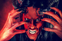 Rage diabolic. Portrait of a devil with horns. Fantasy. Art project Stock Photos