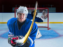 Rage hockey defenceman protecting his goals Stock Photos