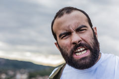 Rage. Portrait of a crazy man showing the teeth in anger Royalty Free Stock Images