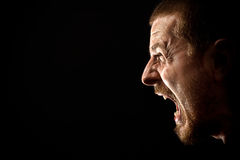 Rage - scream of angry man. Angry man screaming in extreme rage Royalty Free Stock Photos
