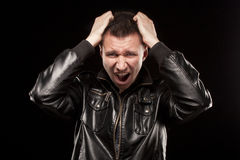 Rage - scream of angry man. Scream of angry man, isolated on black backfround Royalty Free Stock Photography