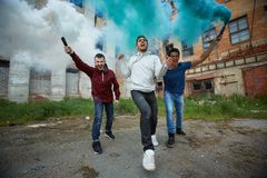 Rage and smoke. Portrait of furious strikers making rebel in ghetto Stock Image