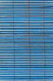 Ragged blue shutters Royalty Free Stock Photography
