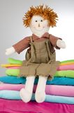 Ragged doll. Sitting on top of fabrics stock photos