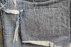 Ragged fabric of old bluejeans. Close up ragged fabric of old bluejeans Stock Photos