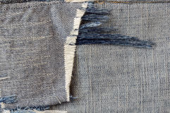 Ragged fabric of old bluejeans. Close up ragged fabric of old bluejeans Stock Photography